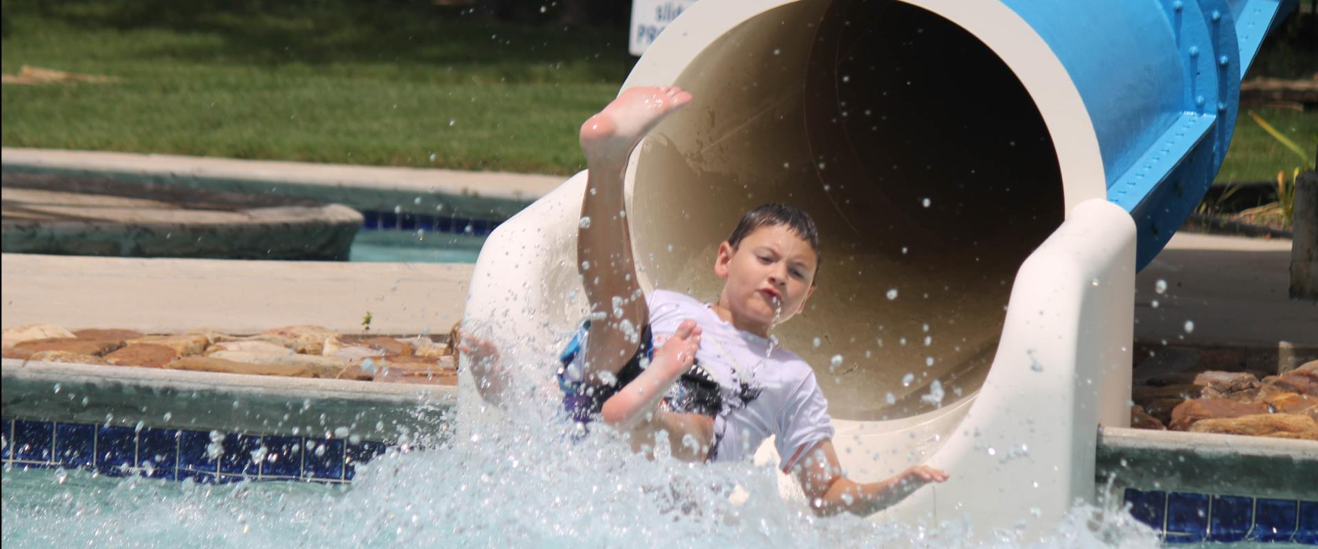 child coming out of water slide